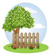 Er is een boom achter een hek.